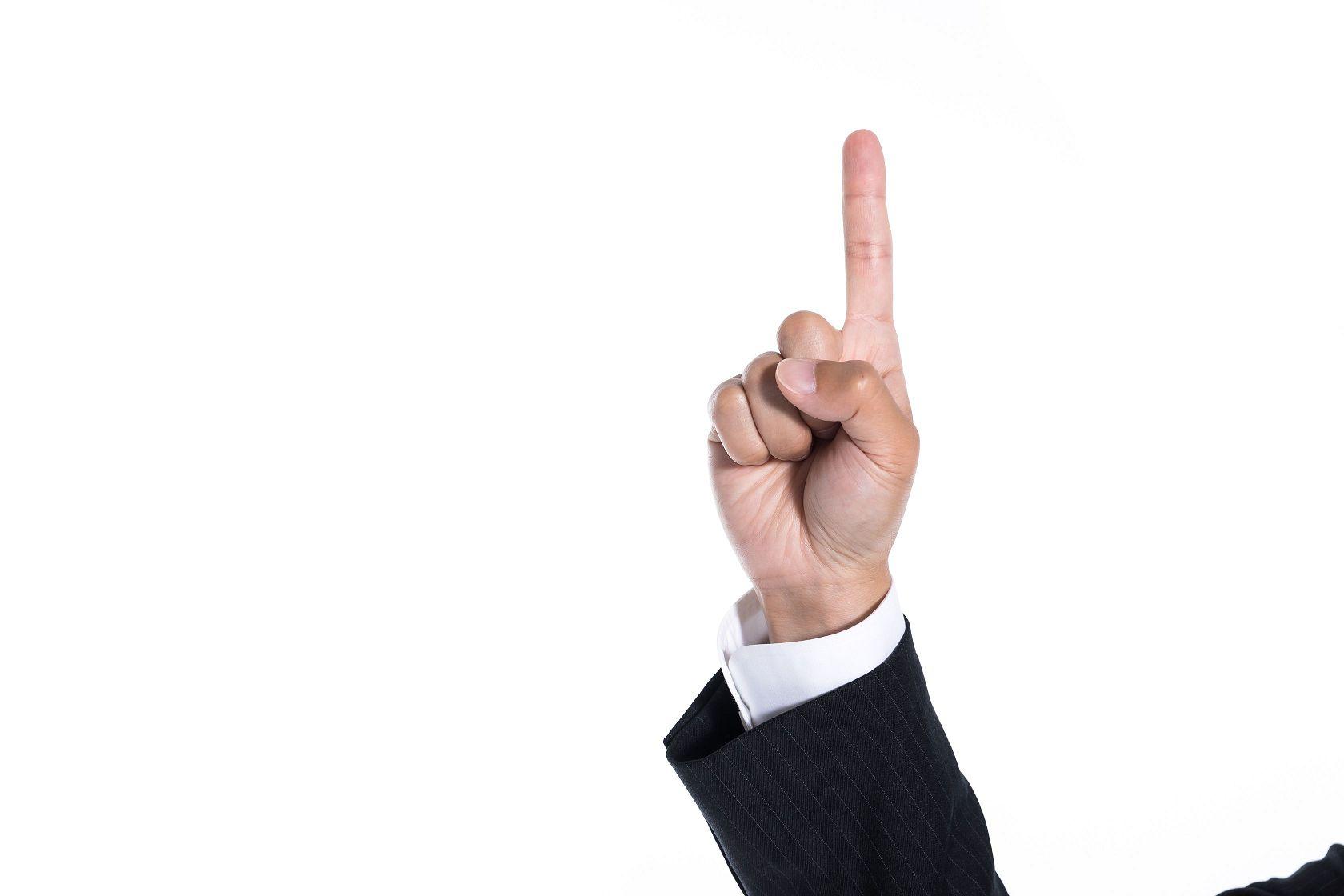 ポイントを説明している人の手